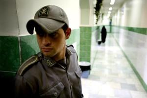 Prison guard stands along corridor in Tehran's Evin prison